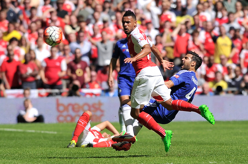 Chelsea's Cesc Fabregasis tackled by Arsenal's Francis Coquelin<br /> <br /> Photographer Ashley Western/CameraSport<br /> <br /> Football - FA Community Shield - Arsenal v Chelsea - Sunday 2nd August 2015 - Wembley Stadium - London<br /> <br /> &copy; CameraSport - 43 Linden Ave. Countesthorpe. Leicester. England. LE8 5PG - Tel: +44 (0) 116 277 4147 - admin@camerasport.com - www.camerasport.com