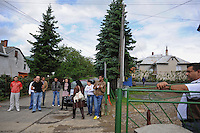 """Members of the Roma or gypsy theater Romathan arrive at the Banske Elementary School with a Roma or gypsy majority student body outside to perform for young children in """"Dwarf"""" in Banske, Slovakia on June 2, 2010."""
