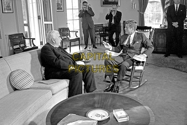 United States President John F. Kennedy (in rocking chair), right, meets with Prime Minister of Australia Robert G. Menzies, left, in the Oval Office of the White House in Washington, DC on September 25, 1962.<br /> Credit: Arnie Sachs / CNP /MPI/Capital Pictures