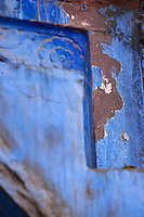 Detail of the distressed paintwork around a door frame