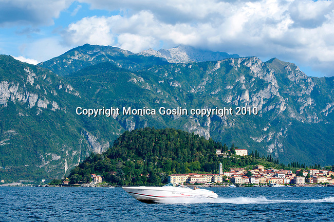 Speed boat on Lake Como, Italy with Bellagio and the Mountains in the background