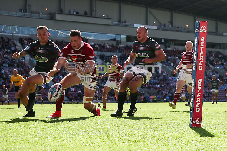Picture by Paul Currie/SWpix.com - 02/07/2017 - Rugby League - Betfred Super League - Wigan Warriors v Widnes Vikings - DW Stadium, Wigan, England - Joe Burgess of Wigan Warriors scoring the 5th try