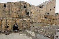 Russian Cultural Palace Kabul. The building was destroyed by the Mujahadeen during the Afghan civil war. Hundreds of people use the building to smoke and inject heroin. The Welfare Association for the Development of Afghanistan (WADAN) has reclaimed part of the building and turned it into a rehabilitation clinic. Addict on the roof of the building.