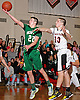 Patrick Quigley #22 of Seaford, left, tries to drive past Robert Ferrufino #13 of Island Trees during a Nassau County varsity boys' basketball game at Island Trees High School on Wednesday, Jan. 13, 2016. Island Trees won by a score of 63-48.