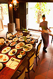 VIETNAM, Hue, a table is set for an early dinner at Ms. Boi Trans home in Hue