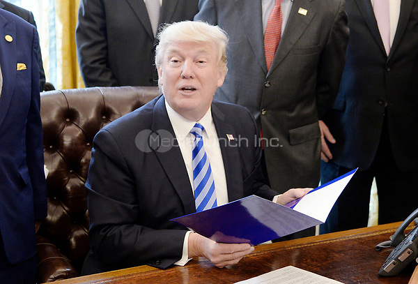 United States President Donald Trump speaks during a National Economic Council meeting where he signed what he described as a &quot;permit&quot; for the construction of the Keystone XL Pipeline in the Oval Office of the White House on March 24, 2017 in Washington, DC. <br /> Credit: Olivier Douliery / Pool via CNP /MediaPunch