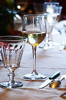Mas de Perry, Mas Nicot. Terrasses de Larzac. Languedoc. France. Europe. Wine glass. In the dining room.
