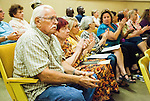 Volunteers for local cat rescue organizations applaud the public speakers pleading with the City Council to reconsider the ban on feeding feral cats on public property in Antioch, California, on August 26, 2014.  Photo/Victoria Sheridan