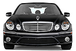 Straight front view of a black 2008 Mercedes E63 Sedan