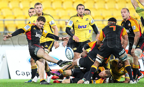17.03.2013 Wellington, New Zealand. Chiefs' Tawera Kerr-Barlow clears the ball during the 2013 Super Rugby season - Hurricanes v Chiefs, Westpac Stadium...