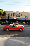 USA, California, San Francisco, a man drives an old classic car down Columbus Ave in North Beach
