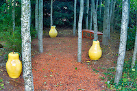 Path made out of hazel nut shells with ceramic pears and bench. Hughes Water Gardens. Oregon