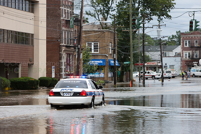 MAMARONECK, NY - AUGUST 28: A village police cruiser drives down flooded Mamaroneck Avenue in the Village of Mamaroneck, New York on Sunday August 28, 2011 in the aftermath of Hurricane Irene.