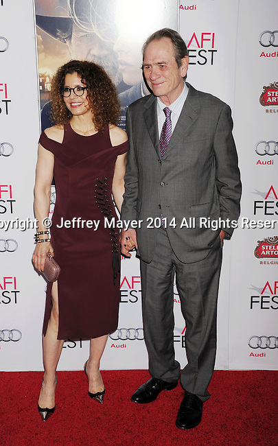 HOLLYWOOD, CA - NOVEMBER 11: Actor/director Tommy Lee Jones (R) and wife Dawn Laurel-Jones attend the 'The Homesman' premiere during AFI FEST 2014 presented by Audi at the Dolby Theater on November 11, 2014 in Hollywood, California.