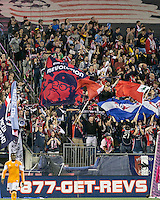 Revolution fans celebrate a goal scored.   The New England Revolution played to a 1-1 draw against the Houston Dynamo during a Major League Soccer (MLS) match at Gillette Stadium in Foxborough, MA on September 28, 2013.