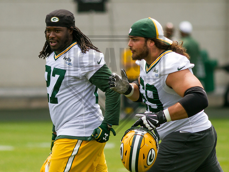 GREEN BAY - June 2015: Green Bay Packers running back Eddie Lacy (27) and tackle David Bakhtiari (69) during a minicamp practice on June 18th, 2015 at Clarke Hinkle Field in Green Bay, Wisconsin. (Brad Krause/Krause Sports Photography)