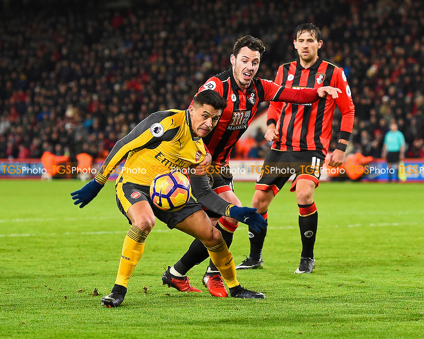 Alexis Sanchez of Arsenal left holds off Adam Smith of AFC Bournemouth during AFC Bournemouth vs Arsenal, Premier League Football at the Vitality Stadium on 3rd January 2017