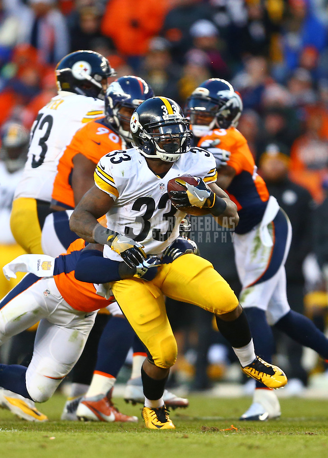 Jan 17, 2016; Denver, CO, USA; Pittsburgh Steelers running back Fitzgerald Toussaint (33) against the Denver Broncos during the AFC Divisional round playoff game at Sports Authority Field at Mile High. Mandatory Credit: Mark J. Rebilas-USA TODAY Sports