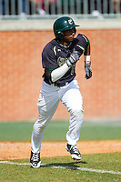 Mikal Hill (8) of the Charlotte 49ers hustles down the first base line against the Canisius Golden Griffins at Hayes Stadium on February 23, 2014 in Charlotte, North Carolina.  The Golden Griffins defeated the 49ers 10-1.  (Brian Westerholt/Four Seam Images)