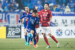 Suwon Midfielder Kim Minwoo (L) fights for the ball with Guangzhou Defender Wang Shangyuan (R) during the AFC Champions League 2017 Group G match Between Suwon Samsung Bluewings (KOR) vs Guangzhou Evergrande FC (CHN) at the Suwon World Cup Stadium on 01 March 2017 in Suwon, South Korea. Photo by Victor Fraile / Power Sport Images