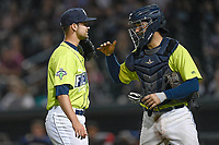 Closing pitcher Stephen Villines (40) of the Columbia Fireflies is congratulated by catcher Ali Sanchez after earning the save in a game against the Greenville Drive on Friday, May 25, 2018, at Spirit Communications Park in Columbia, South Carolina. Columbia won, 3-1. (Tom Priddy/Four Seam Images)
