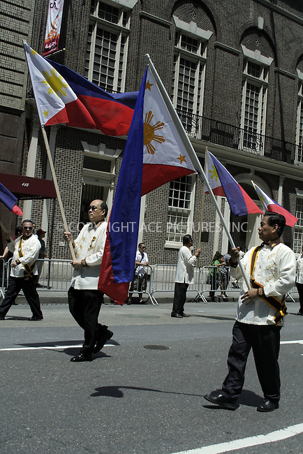 WWW.ACEPIXS.COM . . . . .  ....June 7, 2009. New York City.....Spectators watch the 2009 Philippine Independence Day Parade on June 7, 2009 in New York City.......Please byline: Joanne Juele - ACEPIXS.COM.... *** ***..Ace Pictures, Inc:  ..Philip Vaughan (646) 769 0430..e-mail: info@acepixs.com..web: http://www.acepixs.com