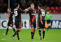 FUSSBALL   CHAMPIONS LEAGUE   SAISON 2011/2012  Bayer 04 Leverkusen - FC Valencia           19.10.2011 Schlussjubel: Michael BALLACK, Simon ROLFES und Eren DERDIYOK (v.l., alle Leverkusen)
