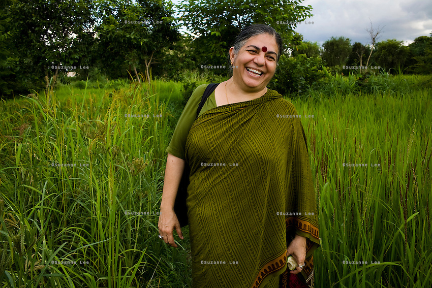 Dr. Vandana Shiva, founder of  Navdanya Foundation and Bijavidyapeeth (College of Seeds) in Dehradun, Uttarakhand, India, laughs as she walks through her farm on 5th September 2009. Dr. Vandana Shiva is a physicist turned environmentalist who campaigns against genetically modified food and teaches farmers to rely on indigenous farming methods.. .Photo by Suzanne Lee