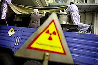 Technicians load highly enriched uranium (HEU) onto trucks at the Institute of Nuclear Physics in Almaty. The removal of Kazakhstan's HEU is part of the U.S. Global Threat Reduction Initiative (GTRI) which tries to secure nuclear material around the world to prevent their misuse.