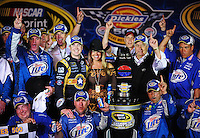 Nov. 8, 2009; Fort Worth, TX, USA; NASCAR Sprint Cup Series driver Kurt Busch (center left) celebrates with wife Eva Busch , crew chief Pat Tryson (left) and car owner Roger Penske (right) after winning the Dickies 500 at the Texas Motor Speedway. Mandatory Credit: Mark J. Rebilas-