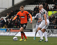 Stuart Armstrong being closed down by Jim Goodwin in the St Mirren v Dundee United Clydesdale Bank Scottish Premier League match played at St Mirren Park, Paisley on 27.10.12.
