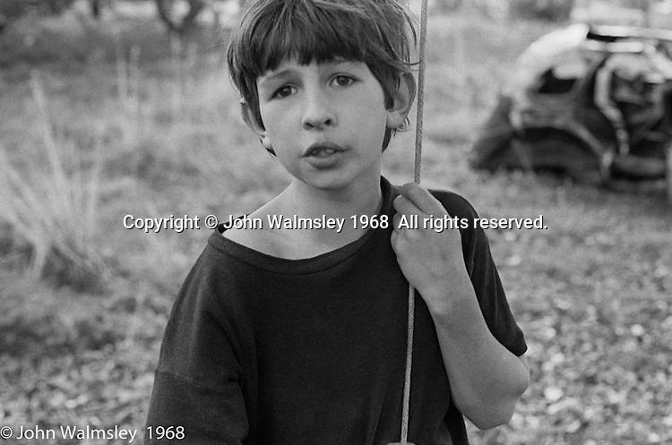 Playing around the trees, Summerhill school, Leiston, Suffolk, UK. 1968.