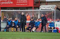Cambridge United manager Shaun Derry (standing, fourth left) during the Sky Bet League 2 match between Cheltenham Town and Cambridge United at the LCI Stadium, Cheltenham, England on 18 March 2017. Photo by Mark  Hawkins / PRiME Media Images.