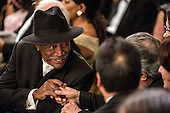 Actor Morgan Freeman greets another guest at the Kennedy Center Honors reception at the White House on December 2, 2012 in Washington, DC. The Kennedy Center Honors recognized seven individuals - Buddy Guy, Dustin Hoffman, David Letterman, Natalia Makarova, John Paul Jones, Jimmy Page, and Robert Plant - for their lifetime contributions to American culture through the performing arts. .Credit: Brendan Hoffman / Pool via CNP