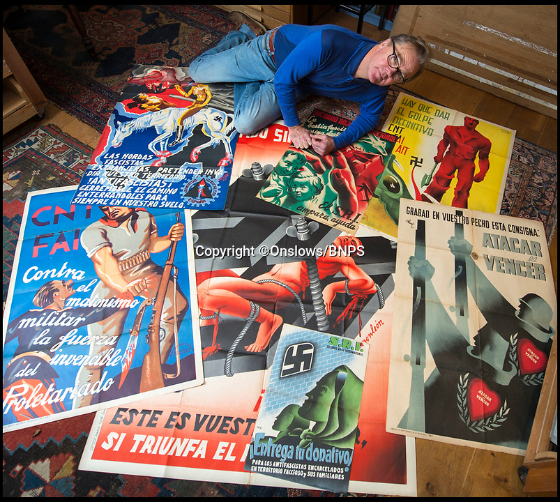 """BNPS.co.uk (01202 558833)<br /> Pic: Onslows/BNPS<br /> <br /> Auctioneer Patrick Bogue with the colourful and poignant collection from Spains very recent past.<br /> <br /> As Spain teeters on the brink of another civil war over the Catalonian independence crisis, a rare collection of posters from the Spanish Civil War of the 1930's have emerged for sale 80 years after the country was last in turmoil.<br /> <br /> The seven posters, which are expected to fetch more than £10,000 at auction, were all made by anti-fascist artists supporting the democratic Republican cause after a group of army generals led by Franco staged a military coup and tried to take control in 1936.<br /> <br /> In a country with a high rate of illiteracy, much of the propaganda produced in the first few years of the war used rousing images to deliver their message to the masses.<br /> <br /> Hitler and Mussolini both sent thousands of troops and weapons to help the right-wing Nationalists and many of the Republican posters slammed the """"foreign fascist hordes"""" and the pictures showed swastika-covered enemies.<br /> <br /> The posters will be sold by Onslows Auctioneers in Stourpaine, Dorset on December 15."""