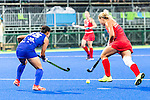 Kelsey Kolojejchick #7 of United States carries past Yukari Mano #13 of Japan during USA vs Japan in a Pool B game at the Rio 2016 Olympics at the Olympic Hockey Centre in Rio de Janeiro, Brazil.