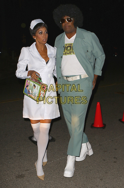 LOS ANGELES, CA - OCTOBER 30: Holly Robinson-Peete and Rodney Peete arriving to the Casamigos Tequila Halloween Party on October 30, 2015 in Los Angeles, California. <br /> CAP/MPI99<br /> &copy;MPI99/Capital Pictures