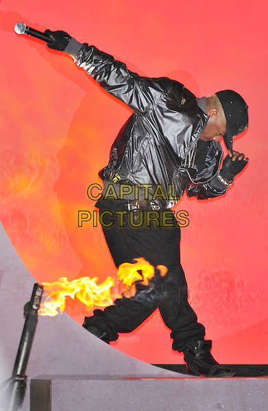 SISQO (Mark Althavean Andrew).Contestants enter the House on the Opening Night of Celebrity Big Brother, Elstree Studios, London, England..January 3rd, 2010.CBB BB full length black hat baseball cap background red hat posing dancing profile microphone  shiny bomber jacket Sisq.CAP/PL.©Phil Loftus/Capital Pictures.