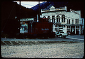 Caboose #0575 on flat bed truck in. Ouray, Colorado. St. Elmo Hotel in background.<br /> D&amp;RGW  Ouray, CO