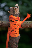 Orange lace holding up cross member of home made soccer goal frame. Zawady Central Poland