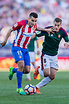 Angel Correa of Atletico de Madrid (L) in action against Oriol Riera Magem of Osasuna (R) during the La Liga match between Atletico de Madrid vs Osasuna at the Estadio Vicente Calderon on 15 April 2017 in Madrid, Spain. Photo by Diego Gonzalez Souto / Power Sport Images