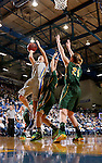 BROOKINGS, SD - JANUARY 31:  Macy Miller #12 from South Dakota State University takes the ball to the basket against Brooke LeMar #4 and Liz Keena #21 from North Dakota State University in the first half of their game Saturday afternoon at Frost Arena in Brookings. (Photo by Dave Eggen/Inertia)