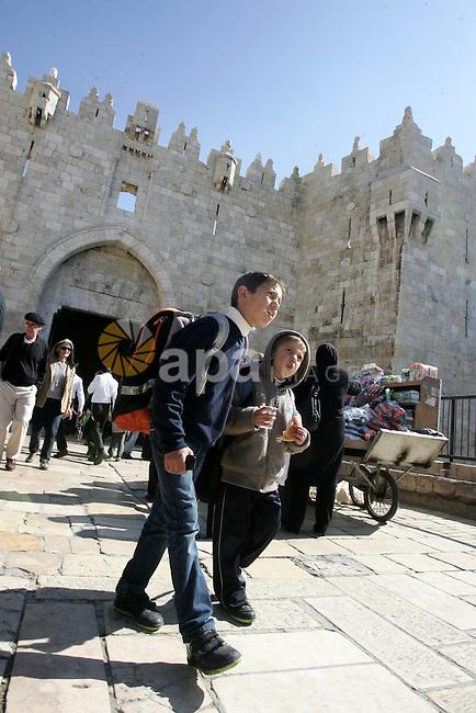 A Palestinian students walk outside Damascus Gate leading into the old city of Jerusalem on March 6, 2012. Photo by Mahfouz Abu Turk