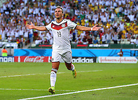 Mario Goetze of Germany celebrates scoring his goal to make the score 1-0