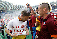 Calcio, Serie A: Lazio vs Roma. Roma, stadio Olimpico, 25 maggio 2015.<br /> Roma's Francesco Totti, left, celebrates with teammate Radja Nainggolan at the end of the Italian Serie A football match between Lazio and Roma at Rome's Olympic stadium, 25 May 2015. Roma won 2-1.<br /> UPDATE IMAGES PRESS/Riccardo De Luca