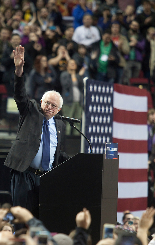 Senator Bernie Sanders takes the stage at a rally in Portland, Oregon Friday March 25, 2016. Sanders spoke to a crowd of more than eleven thousand about a wide range of issues, including getting big money out of politics, his plan to make public colleges and universities tuition-free, combating climate change and ensuring universal health care.  Photo by Natalie Behring