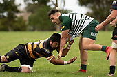 Joshua Tafili tries to avoid Ki Anufe's tackle.  Counties Manukau Club Rugby game between Manurewa and Bombay played at Mountfort Park Manurewa on Saturday June 2nd 2018. Bombay won the game 27 - 20 after leading 20 - 5 at halftime. <br /> Manurewa Kidd Contracting 20 - Caleb Fa'alili, William Raea, Willie Tuala, Viliami Taulani tries.<br /> Bombay 27 - Liam Daniela, Sepuloni Taufa, Talaga Alofipo tries, Ki Anufe 3 conversions, Ki Anufe 2 penalties.<br /> Photo by Richard Spranger.
