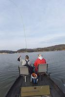 NWA Democrat-Gazette/FLIP PUTTHOFF <br />Rance Carter (left) uses long fishing rods in his spider rig set-up.