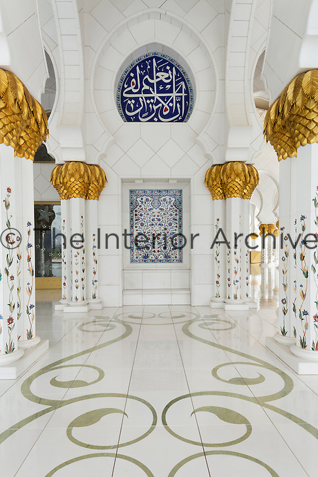 The Sheikh Zayed Grand Mosque in Abu Dhabi, also known as the White Mosque, is a masterpiece of architecture and craftsmanship. Inlaid in marble, flower stems from traditional Iznik ceramic patterns climb the columns.