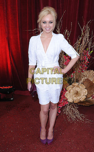 JORGIE PORTER.The British Soap Awards 2010, London Television Centre, London, England..8th May 2010.arrivals full length white puff sleeve dress wrap belt waist purple shoes platform shirt hand on hip pink.CAP/BEL.©Tom Belcher/Capital Pictures.